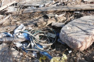 Garden hose and other washed up items.
