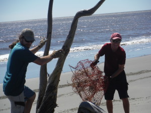 John and Fred removing the crab trap decorations from the tree.